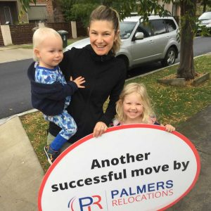 Happy Customers Holding a Palmers Sign